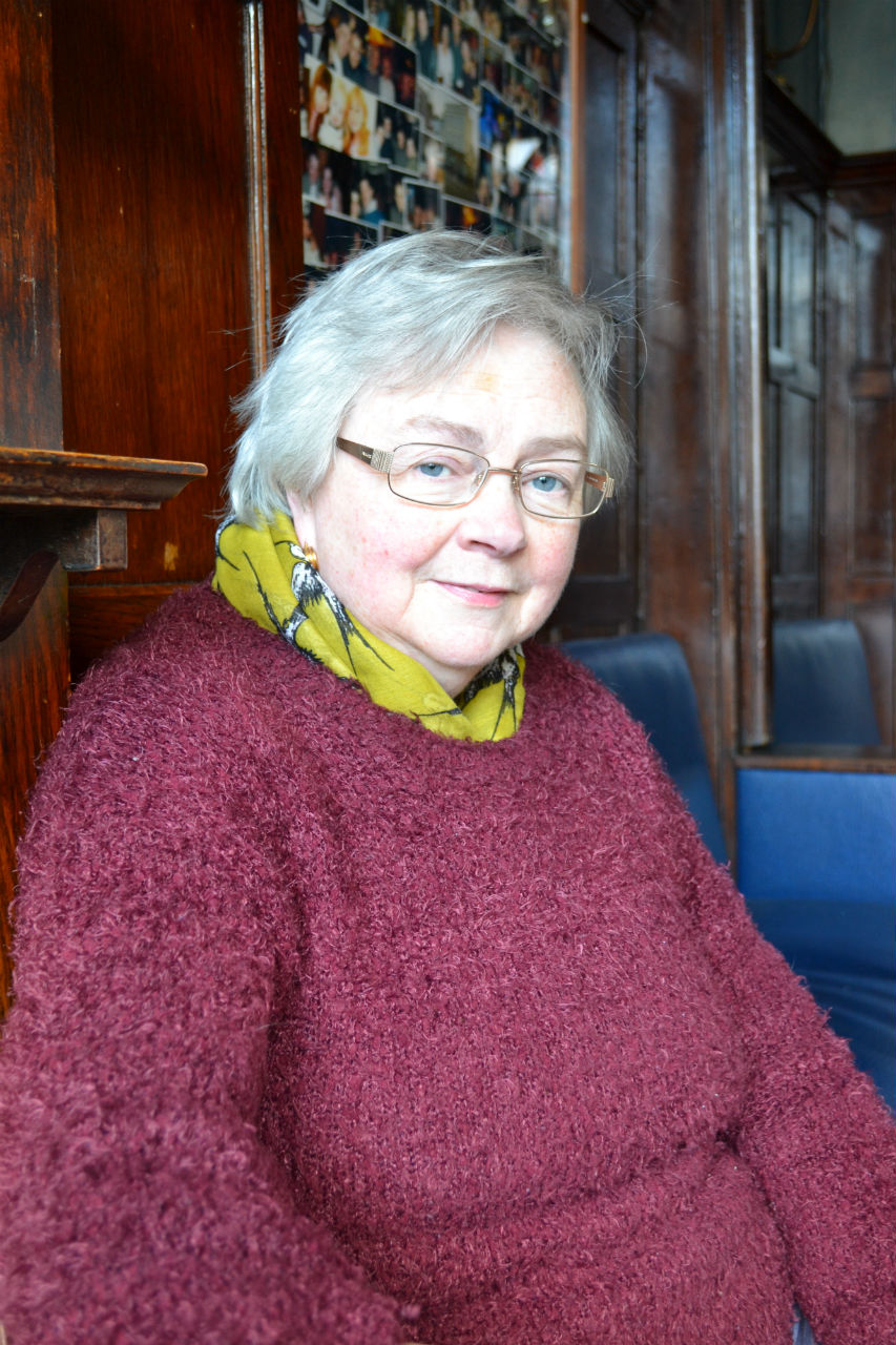 Martha McGrath sitting by the open fire. Photo: SE