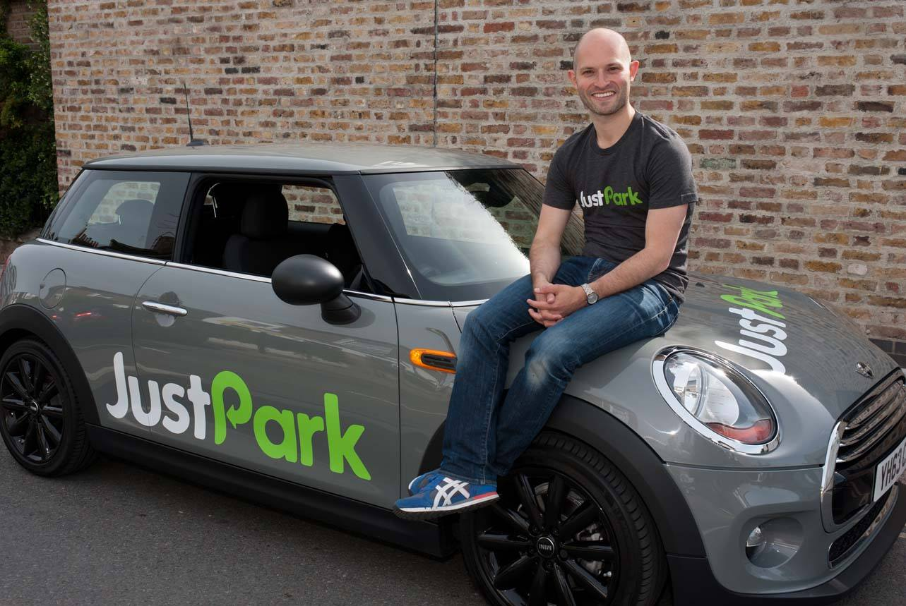 Alex in his JustPark days, with a Mini that has their parking space-finding tech built in to the dashboard. Photo: PR