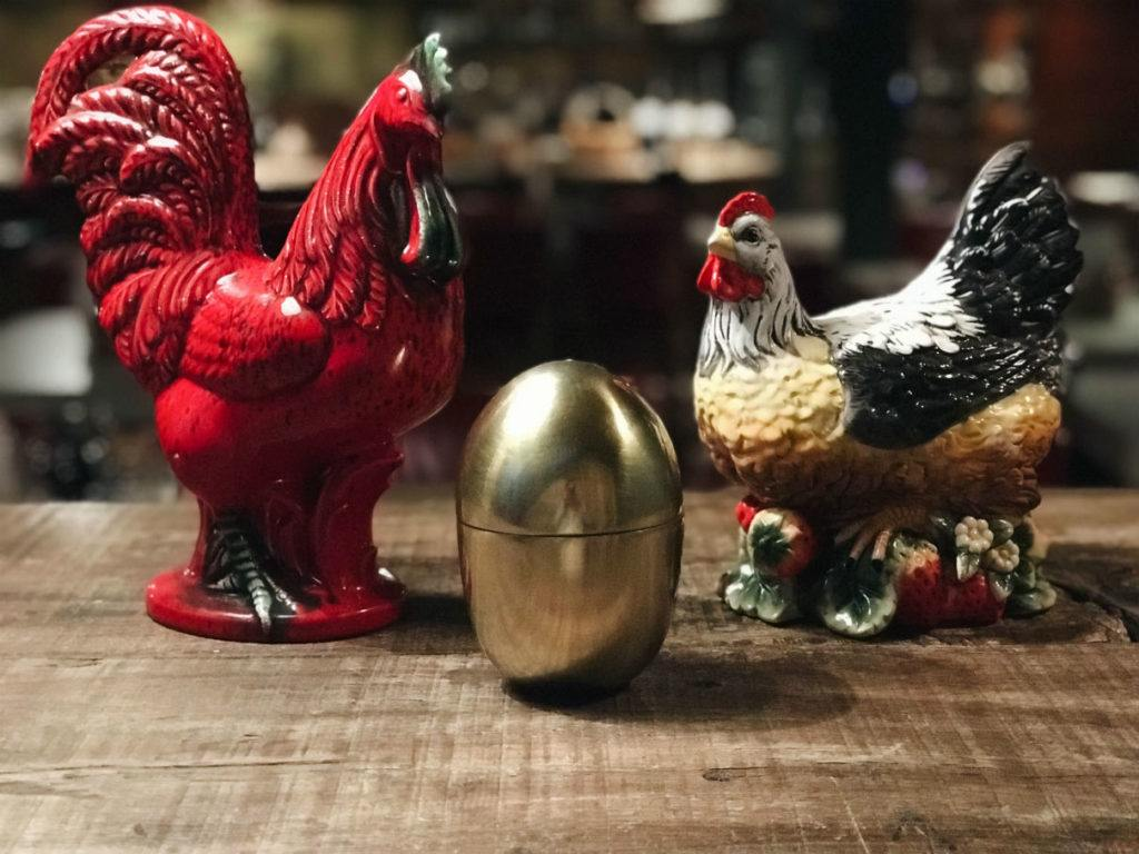 Two clay chickens and a golden egg at the Chicken Shop