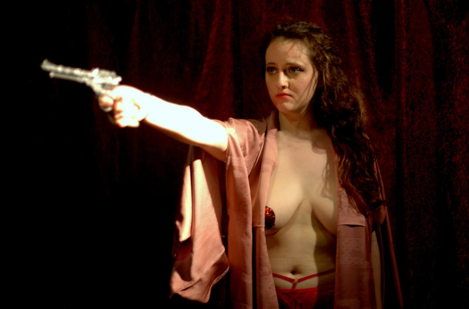 A half-naked girl pointing a gun on stage at Camden Fringe