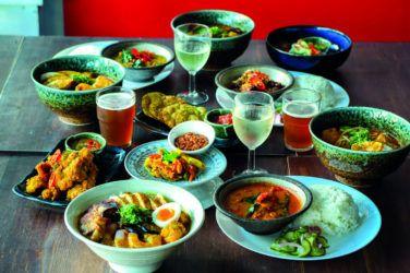 Plates of asian food in Sambal Shiok