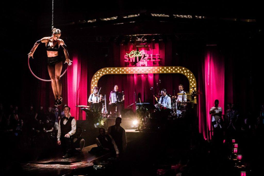 The stage and performers at Club Swizzle