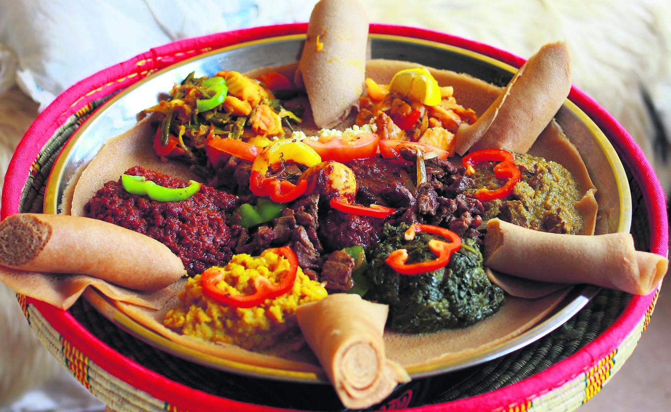 Sharing plate of food at Harar